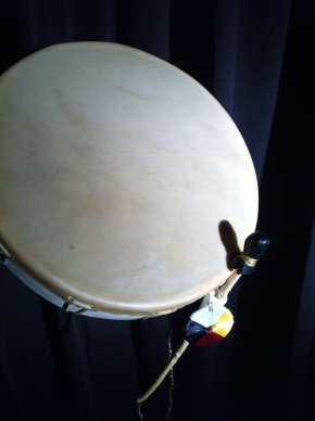 The stick and robe are at an angle on the drum